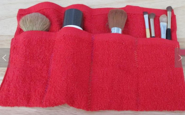 Makeup brush travel pouch red color with make up brushes inside it